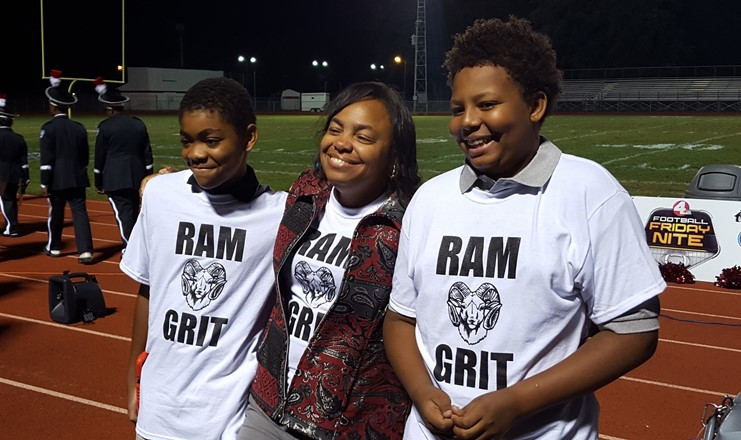Principal and students wearing RAM GRIT t-shirts