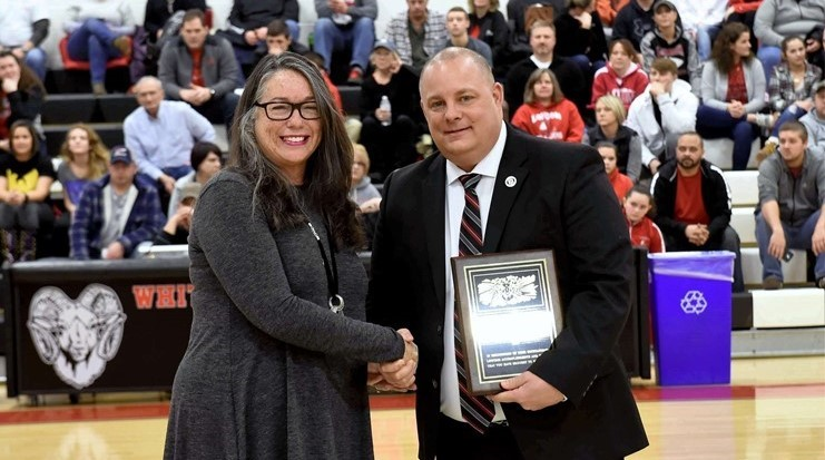 2018 WYHS HOF Inductee, Julie Lynch, receives her plaque from WYHS Principal, Paul Smathers