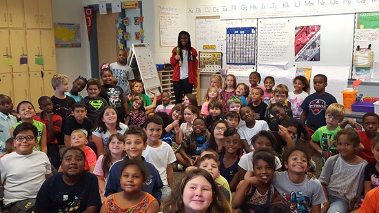 Nichelle Prince of Team Canada shows off her 2016 Bronze Olympic Medal to a class of Beechwood Elementary students.
