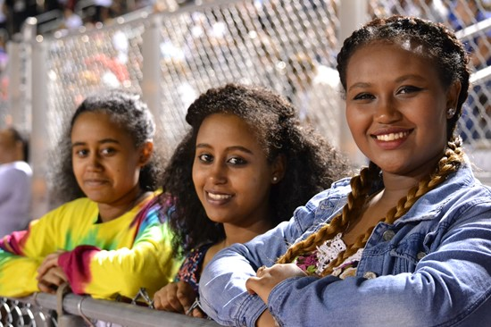 Three WYHS students enjoying a varsity football game.