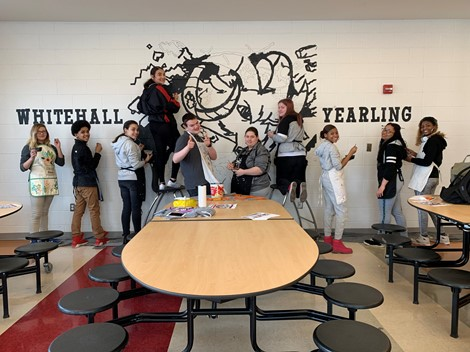 WYHS students painting the cafeteria mural
